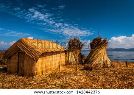 Uros Floating islands in Titikaka lake in the Border bttween Peru and Bolivia, Peru #1428442376