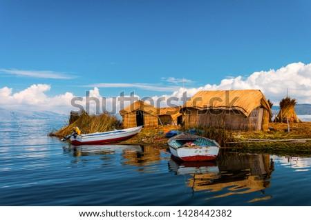 Uros Floating islands in Titikaka lake in the Border bttween Peru and Bolivia, Peru #1428442382