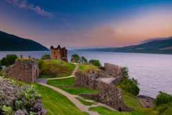 Urquhart Castle at sunset located on the banks of Loch ness, Scotland.