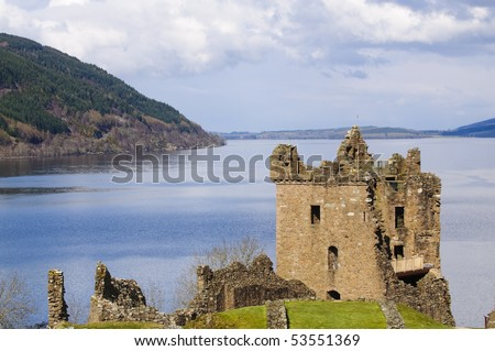 "Urquhart Castle on Loch Ness in Scotland the home of the clan Grant, and the place of the most sightings of ""Nessy"" the famous Loch Ness monster - stock photo"