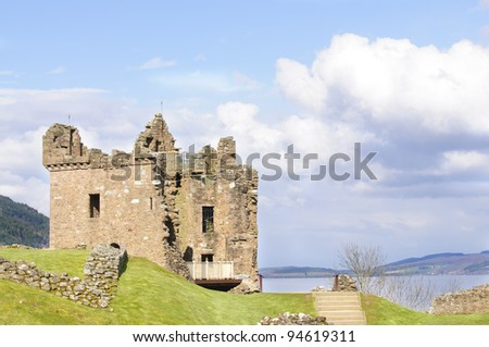 """Urquhart Castle on Loch Ness in Scotland the home of the clan Grant, and the place of the most sightings of """"Nessy"""" the famous Loch Ness monster - stock photo"""
