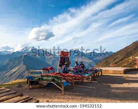 URUBAMBA, PERU - AUGUST 3, 2011: Indian women in national clothes sells the products of her weaving in the tourist spot of Sacred Valley on the road from Cuzco - August 3, 2011 in Urubamba, Peru #194532152