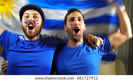 Shutterstock Uruguaian Friends Celebrating with Urugay Flag