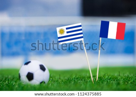 Uruguay and France national Flag on football stadium. Uruguay - France, Quarterfinal. 6. July, Football World Cup, Russia 2018 #1124375885