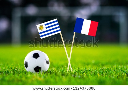 Uruguay and France national Flag on football stadium. Uruguay - France, Quarterfinal. 6. July, Football play-off #1124375888