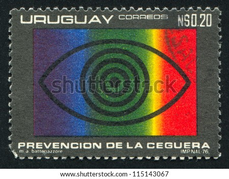 URUGUAY - CIRCA 1976: stamp printed by Uruguay, shows Eye and Spectrum, circa 1976