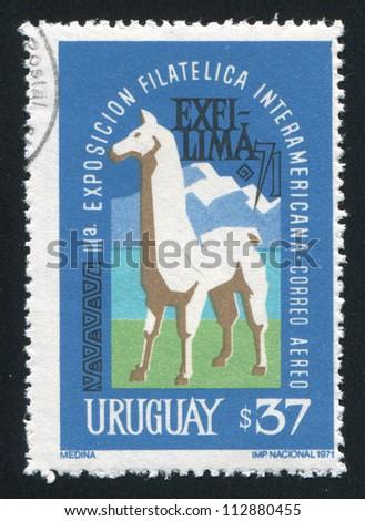 URUGUAY - CIRCA 1971: stamp printed by Uruguay, shows lama and Mountains, circa 1971