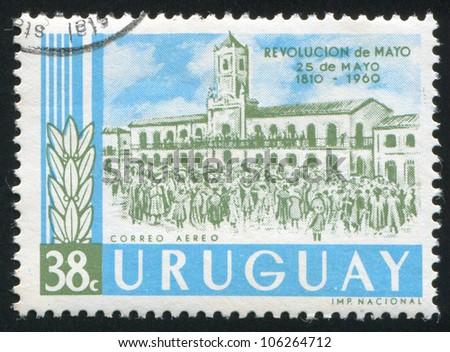 URUGUAY - CIRCA 1960: stamp printed by Uruguay, shows Revolutionists and Cabildo, Buenos Aires, circa 1960