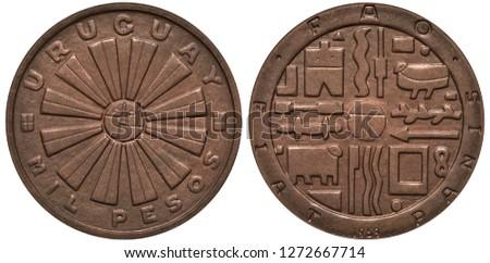 Uruguay Uruguayan coin 1000 one thousand pesos 1969, radiant sun in center, various Indian drawings,