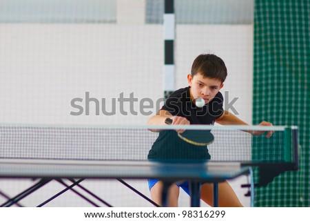 URYUPINSK- RUSSIA - MARCH 17: athlete indoor table tennis indoor, ping-pong, Maxim Nevedrov (pictured), 14 Open Championship of memory Uryupinsk NS Demidenko, Uryupinsk-Russia, March 17 2012.