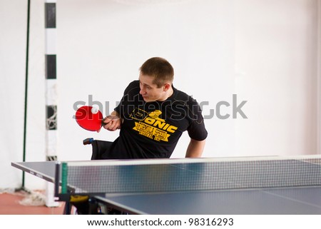 URYUPINSK- RUSSIA - MARCH 17: athlete sport young table tennis, ping-pong,  disabled athlete, Alexander Gorsky, 14 Open Championship of memory Uryupinsk NS Demidenko, Uryupinsk-Russia, March 17 2012.