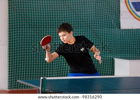 URYUPINSK- RUSSIA - MARCH 17: athlete table tennis, ping-pong, Young Max Nevedrov, 14 Open Championship of memory Uryupinsk NS Demidenko, Uryupinsk-Russia, March 17 2012. teenagers playing