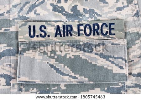 Photo of  US AIR FORCE branch tape on digital tiger-stripe pattern Airman Battle Uniform (ABU) background