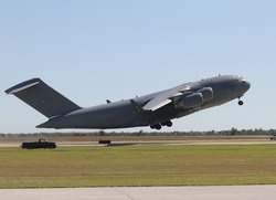 US Air Force military cargo airplane taking off
