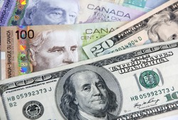 US American dollars vs. Canadian dollars, which are important for board trading between these neibouring coumtries