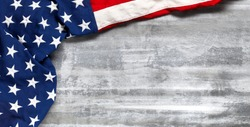 US American flag on worn white wooden background. For USA Memorial day, Veteran's day, Labor day, or 4th of July celebration. With blank space for text.