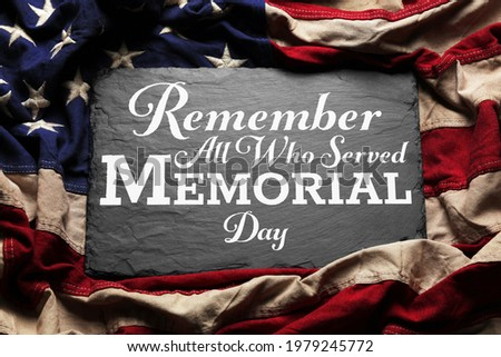 US American flag over Remember and Honor All Who Served Memorial Day Text. USA national holiday.