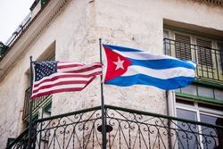 US and Cuban flags side by side in Havana, Cuba