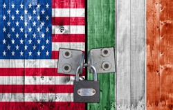 US and Ireland flag on door with padlock