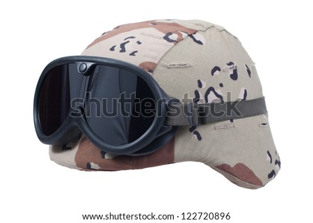 us army kevlar helmet with a desert camouflage cover and protective goggles - stock photo
