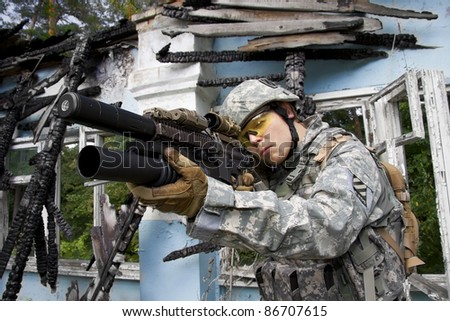 US Army Soldier in action in the ruins
