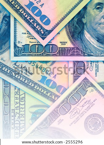 US Banknotes in hundred dollar bills colorful background