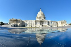 US Capitol Building and mirror reflection - Washington DC United States