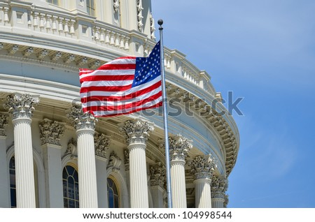 US Capitol Building dome detail with flapping US flag - Washington DC United States ストックフォト ©