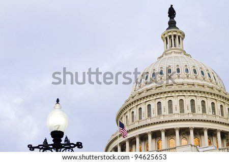 US Capitol Building Dome with American Flag and street light at sundown, Washington, DC, US Congress,