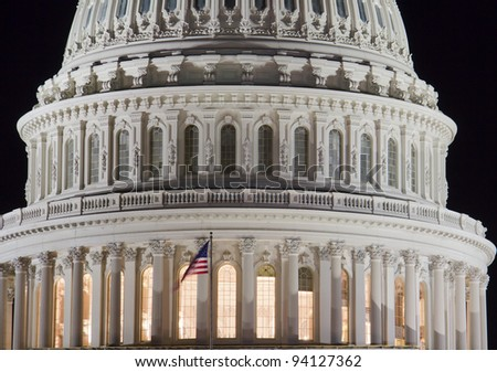 US Capitol building dome with American Flag, at night, Washington DC