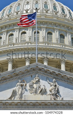 US Capitol Building east facade dome detail with flapping US flag - Washington DC