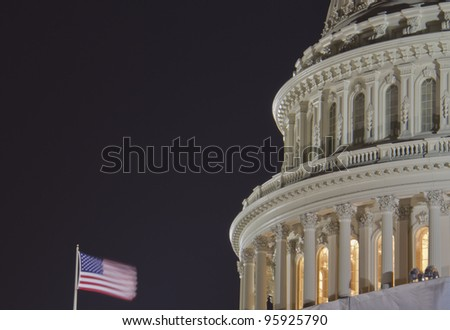 US Capitol dome detail with American Flag at night - Washington DC USA, close up view