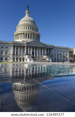 US Capitol Hill east facade and mirror reflection on stone stand - Washington DC, United States