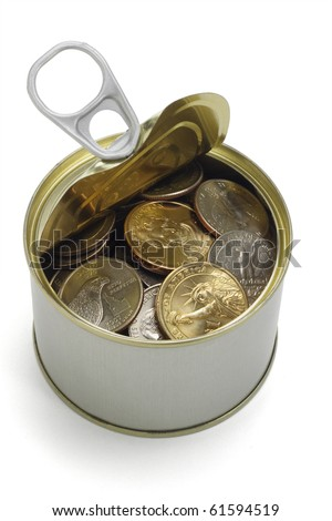 US coins in open tin can on white background
