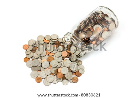 US Coins Spilled Out Of A Jar  Onto A White Background