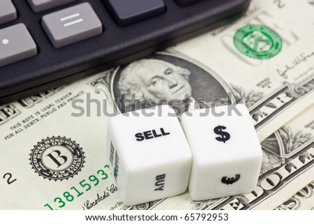 US currency with calculator and dice
