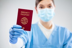 US doctor holding red global immunity passport,SARS re-infection risk-free PCR certificate concept,recovered COVID-19 patient receive convalescence proof,Coronavirus pandemic track trace ID document