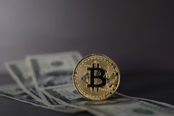 US Dollar and Digital money Bitcoin coin Put together. Concept of digital money is becoming a competitor in major currencies such as the dollar.