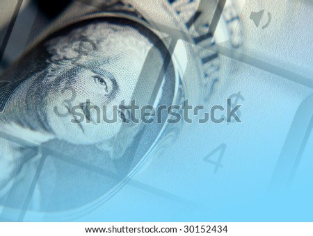 US dollar bank note overlaid over laptop keys