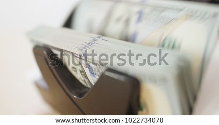 US dollar banknote in counting machine