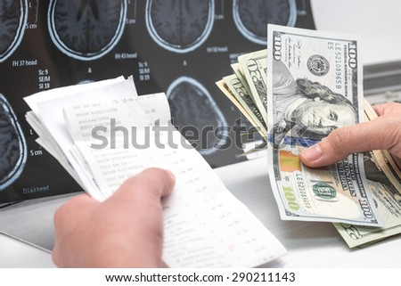 US dollar banknotes and bill with brain x ray film for medical expense background