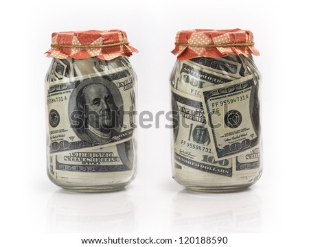 US dollar banknotes in jars on white background