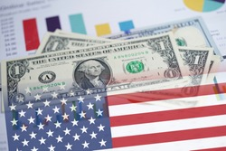 US dollar banknotes money on chart graph spreadsheet paper with USA America Flag. Financial , Banking Account, Statistics, Investment Analytic research data economy, trading, Business.