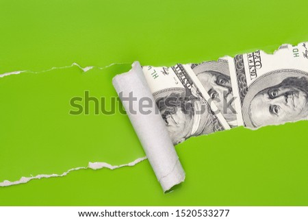 US dollar cash find through the torn green paper. Discovery, finding money, luck concept #1520533277