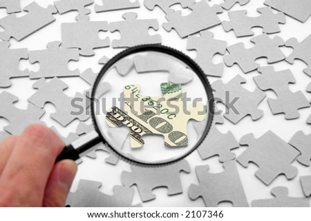 us dollar puzzle and magnifier, business concept