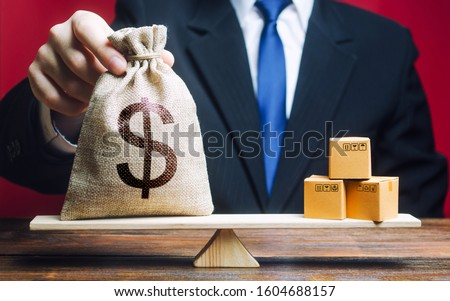 US dollar USD symbol money bag and a bunch of boxes on scales. Trade exchange balance. Import and export, economic processes. Profit from manufactured goods. Manufacturing, retail distribution