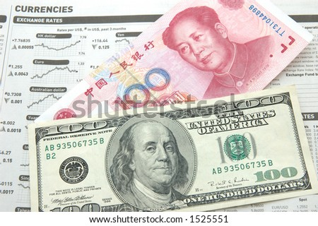 US dollar vs renminbi over the newspaper financial page