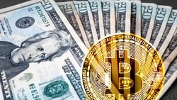 US dollars and Bitcoin Crypto Currency side by side. A battle rages which is a better store of value, digital  versus fiat losing purchasing power. Bitcoin slowly dominating but faces regulation