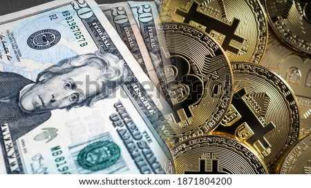 US dollars and Bitcoin Crypto Currency side by side. A battle rages which is a better store of value, digital  versus fiat losing purchasing power. Bitcoin slowly dominating but faces regulation Foto stock ©