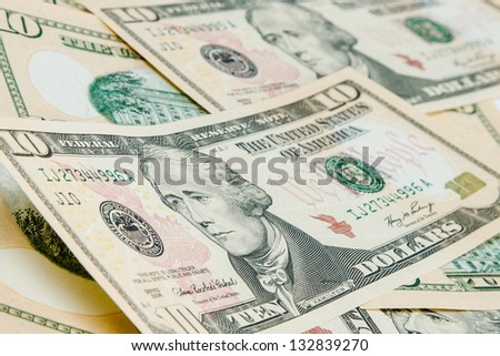 US Dollars background with focus on Alexander Hamilton